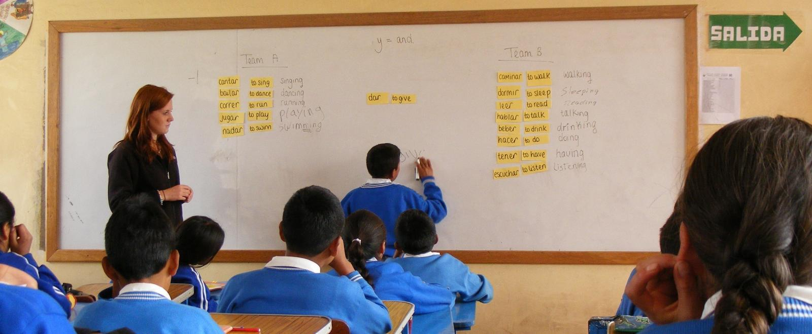 A student finishes an English exercise on the white board at a volunteer teaching placement in Peru.